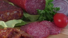 Sausage of salami on a cutting board stock footage