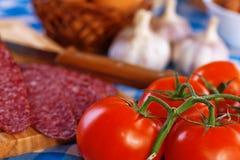 Sausage (salami), garlic, tomato Royalty Free Stock Image