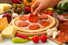 Sausage and salami on top of the pizza Stock Photo