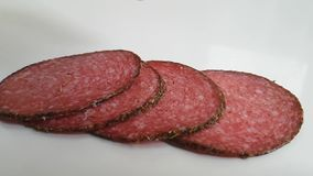 Sausage salami on a white background. Slow-motion shotn stock video footage