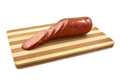 Sausage salami on the wooden desk Stock Photos