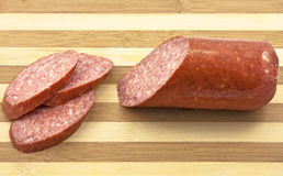 Sausage salami on the wooden desk Royalty Free Stock Photos