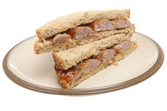 Sausage Sandwich. Pork sausages in between slices of granary bread Royalty Free Stock Photos