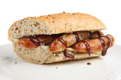 Sausage Sandwich. Sausages in a wholemeal baguette with brown/barbecue sauce Stock Photography