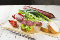 Sausage, sandwich with lettuce and slices of sausage.  Stock Photos