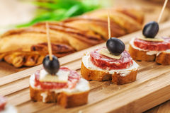 Sausage sandwiches, cheese and olives Stock Photos
