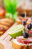 Sausage sandwiches, cheese and olives Royalty Free Stock Images