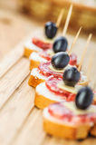 Sausage sandwiches, cheese and olives Stock Images