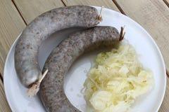 Sausage with sauerkraut Stock Images