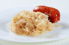 Sausage and sauerkraut Royalty Free Stock Photography