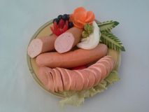 Sausage. S are arranged on a plate to await consumers Royalty Free Stock Photography