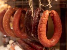 Sausage on the shop window stock photos