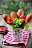 Sausage on a skewer in a corn dough deep fried, homemade corn dogs Royalty Free Stock Images