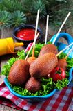 Sausage on a skewer in a corn dough deep fried, homemade corn dogs Stock Photography