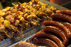 Sausage and skewers on a grill Royalty Free Stock Photography