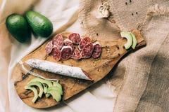 Pieces of sausage and avocado stock photos