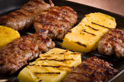 Sausage and sliced of polenta Royalty Free Stock Image
