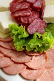 Sausage slices with lettuce leaf Royalty Free Stock Photography