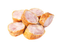 Sausage slices on a white Royalty Free Stock Images