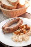 Sausage with sour cabbage Stock Image