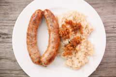 Sausage with sour cabbage Royalty Free Stock Images