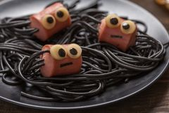 Sausage and spaghetti funny spiders for kids. Sausage and spaghetti funny spiders for Halloween kids lunch stock photos