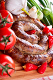 Sausage with spices, tomatoes and red pepper Stock Photo