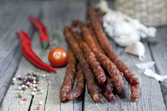 Sausage and spices on vintage wooden boards stock images