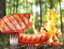 Sausage and steak on a fork. Stock Photography