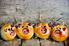 Sausage stuffed piglet buns royalty free stock photography