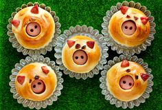 Sausage stuffed piglet buns, homemade burger buns shaped funny pigs faces. For kids party stock photo