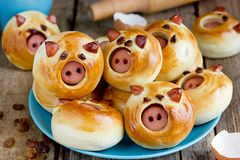 Sausage stuffed piglet buns on plate royalty free stock photography