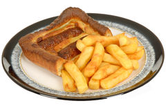 Sausage Toad in the Hole with Chips Stock Photo