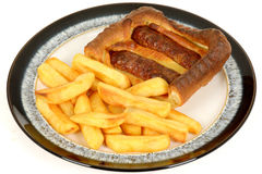 Sausage Toad in the Hole with Chips Royalty Free Stock Photography