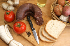 sausage and toast on a timber board Royalty Free Stock Photos