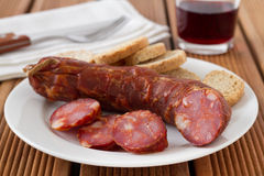Sausage with toasts Stock Photography