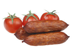 Sausage and tomatoes Royalty Free Stock Image