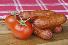 Sausage and tomatoes Royalty Free Stock Photography
