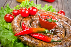 Sausage with tomatoes and hot peppers Stock Photography