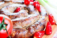 Sausage with tomatoes and  spices Royalty Free Stock Image