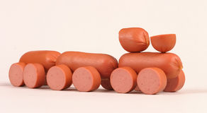 Sausage toy-train. Little toy-train made of meat sausage Royalty Free Stock Image