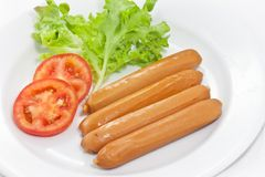 Sausage and vegetables Stock Images