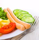 Sausage with vegetables. On plate Stock Image