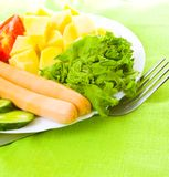 Sausage with vegetables Stock Photos