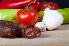 Sausage with vegetables Royalty Free Stock Images