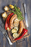 Sausage and vegetables cooked on the grill. Royalty Free Stock Photos
