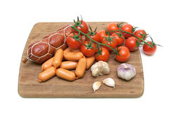 Sausage and vegetables on a cutting board Stock Photos