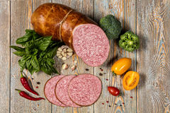 Sausage And Vegetables On An Old Wooden Desk Stock Photo
