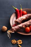 Sausage with walnut and peppers Stock Photography