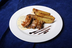 Sausage and wedges Stock Photo